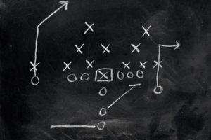 american football tactics on a blackboard
