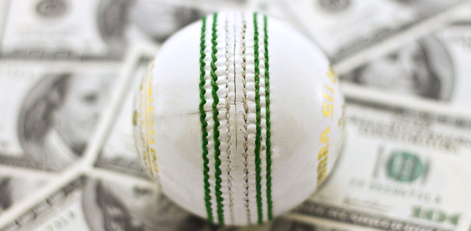 cricket ball and money