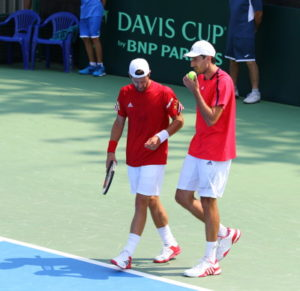 davis cup doubles match players discuss strategy