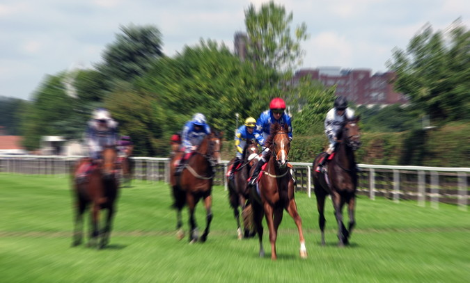 ebor festival at york racecourse horses running blurred out