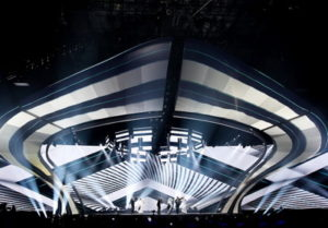 eurovision song contest performers on stage with modern backdrop