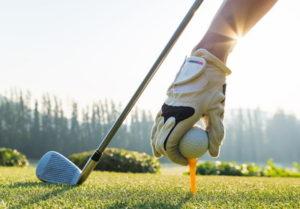 golfer setting up a tee shot