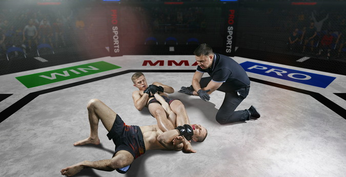 mma fighter holds another man in a hold