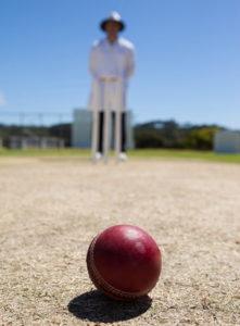 umpire stood over a cricket ball