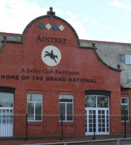 aintree home of the grand national sign