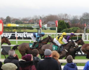 aintree horses running past the winners post
