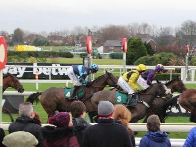 aintree horses running past the winners post