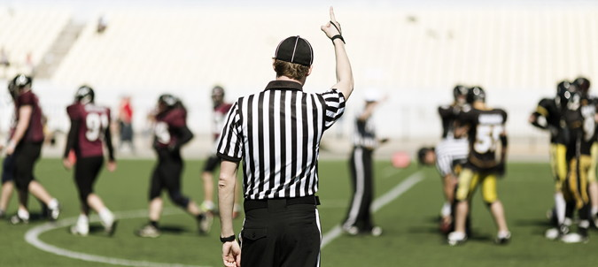 american football referee making a decision during a game