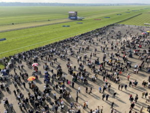 bookmakers and punters from above newmarket racecourse