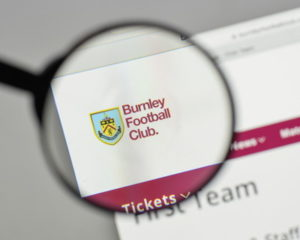 burnley football club website with name under magnifying glass