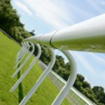 rail along the side of a horse racing track