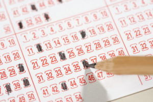 close up of national lottery slip being filled in