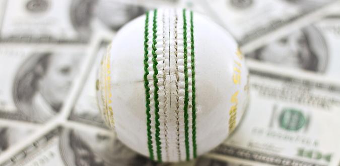 cricket ball and money
