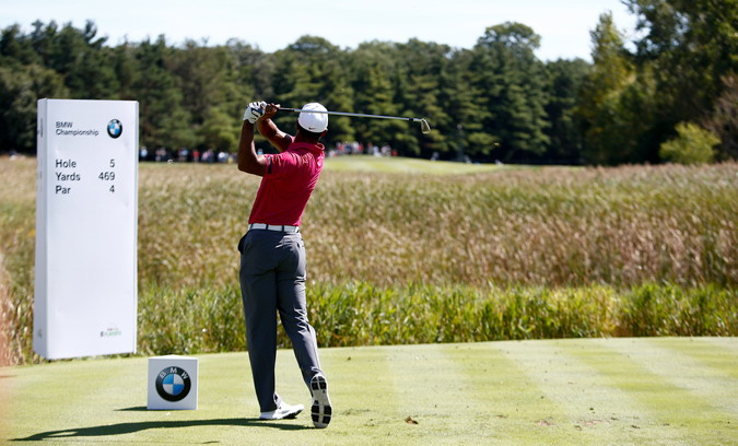 fedex cup bmw champiosnhip golfer takes a shot