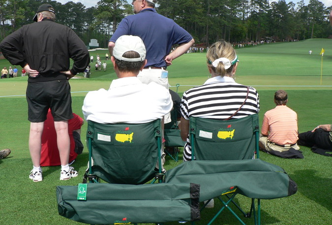 golf at augusta spectators watching in branded chairs