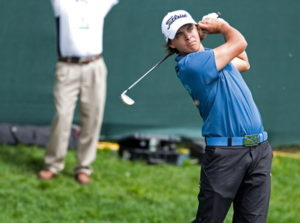 golfer takes a swing at the open