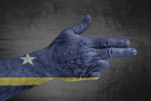 hand in a gun pose painted with curacao flag