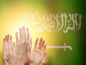 hand raised up onto saudi arabia flag human rights concepy