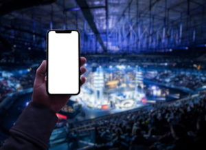 holding phone at sporting event