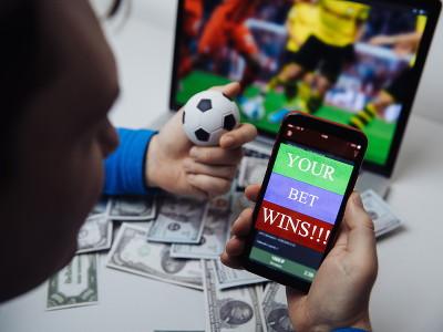 live football man placing a bet