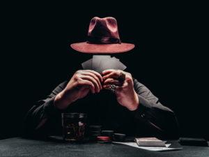 mafia man playing poker
