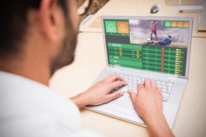 man betting on sports online