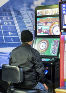 man playing a fixed odds betting terminal