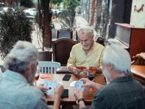 men playing poker in a bar