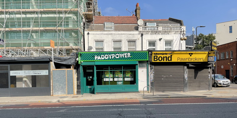 paddy power shop on deprived high street next to pawn brokers