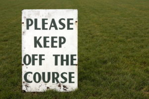 racecourse please keep off the grass sign