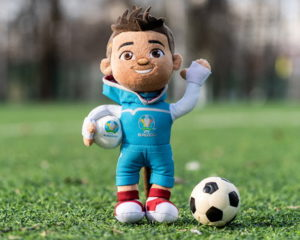 skillzy euro 2020 mascot on grass with ball