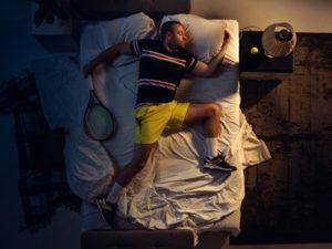 tennis player asleep resting