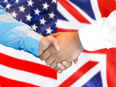 us uk handshake with flags in the background