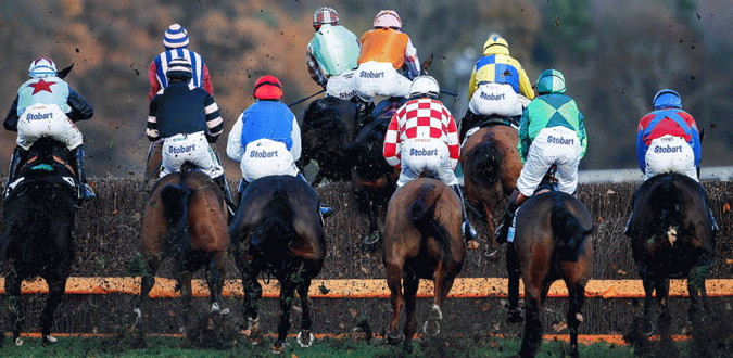 welsh grand national horses lining up to jump a fence
