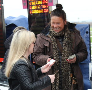 woman placing a bet at aintree